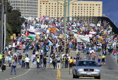 Thousands of pro-Palestinian protesters march towards the Port of Oakland to attempt a blockade of the Israeli cargo ship Zim, which was scheduled to dock at the port in Oakland, Calif. on Saturday, Aug. 16, 2014.