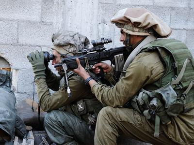 """6 áéðåàø 2009ëåçåú öä""""ì áôòéìåú ÷ø÷òéú áúåê øöåòú òæä.öéìåí: îúï çëéîé, ãåáø öä""""ìJanuary 06, 2009IDF forces during ground maneuvers in the Gaza StripCredit: Matan Hakimi, IDF Spokesperson"""