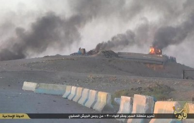 Buildings at the Iraqi Army camp burn