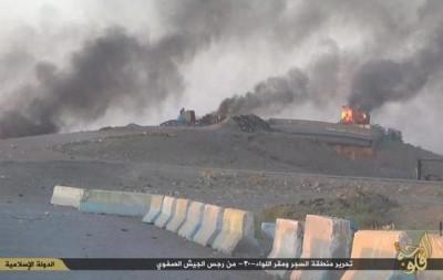 Buildings at the Iraqi Army camp burn