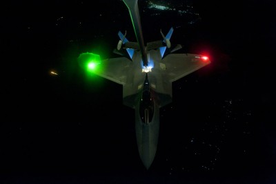 A U.S Air Force KC-10 Extender refuels an F-22 Raptor fighter aircraft prior to strike operations in Syria in this September 26, 2014 photo released on September 29, 2014. REUTERS/Russ Scalf/U.S. Air Force photo/Handout