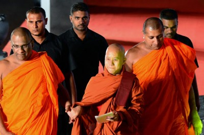 The monk Ashin Wirathu, center, was the guest of honor at the Buddhist Power Force convention in Colombo, Sri Lanka, on Sunday. Credit Lakruwan Wanniarachchi/Agence France-Presse — Getty Images