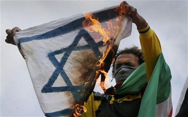 German muslim burns Israeli flag