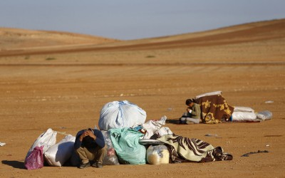 Syrian Kurdish refugees sit next to their belongings in a field where they spent the night near Mursitpinar border crossing in the southeastern Turkish town of Suruc in Sanliurfa province September 30, 2014. REUTERS/Murad Sezer