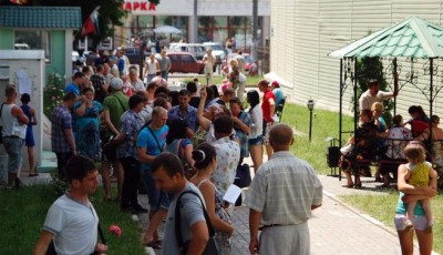File photo of people gathering outside office of Russian federal migration service in Belgorod