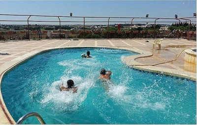 Jihadi fighters have been pictured swimming in hotel pools and eating in upmarket restaurants around Raqqa