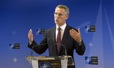 Incoming NATO Secretary General Jens Stoltenberg addresses a first media conference at NATO headquarters in Brussels on Wednesday, Oct. 1, 2014. AP Photo