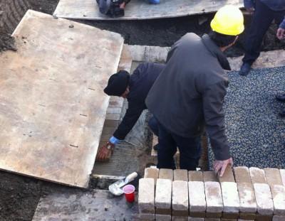 Laying bricks for foundation of new mosque in Regina. Deborah Shawcross/CJME