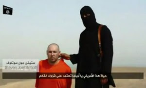 Steven Sotloff with ISIS captor. Photo: screengrab