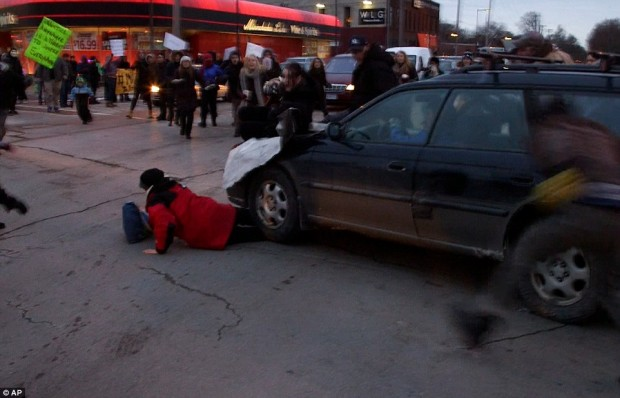 Car Drives Through Protesters