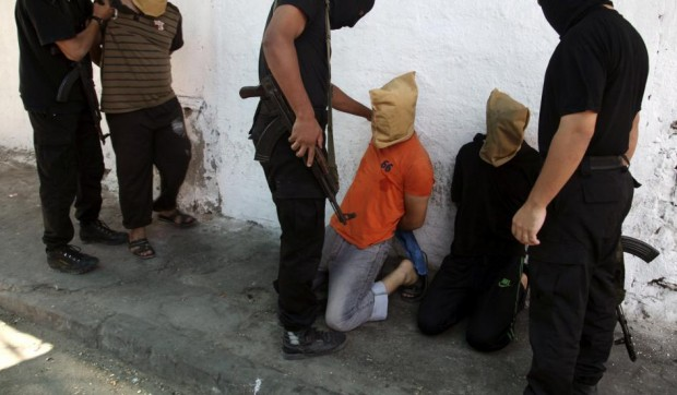 Hamas-led gunmen in Gaza executed 18 Palestinians accused of collaborating with Israel