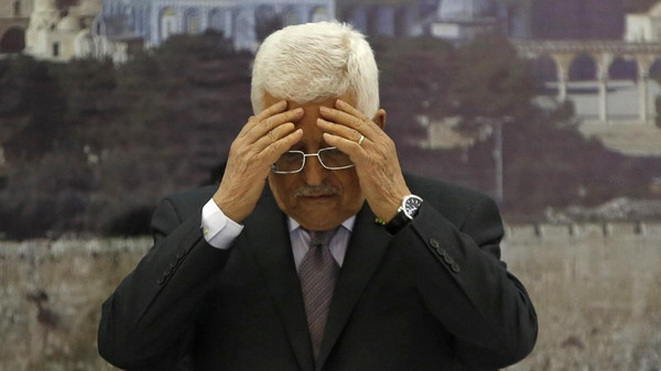 Palestinian President Mahmoud Abbas prays at the start of a meeting with the Palestinian leadership following the death of Palestinian minister Ziad Abu Ein, in Ramallah