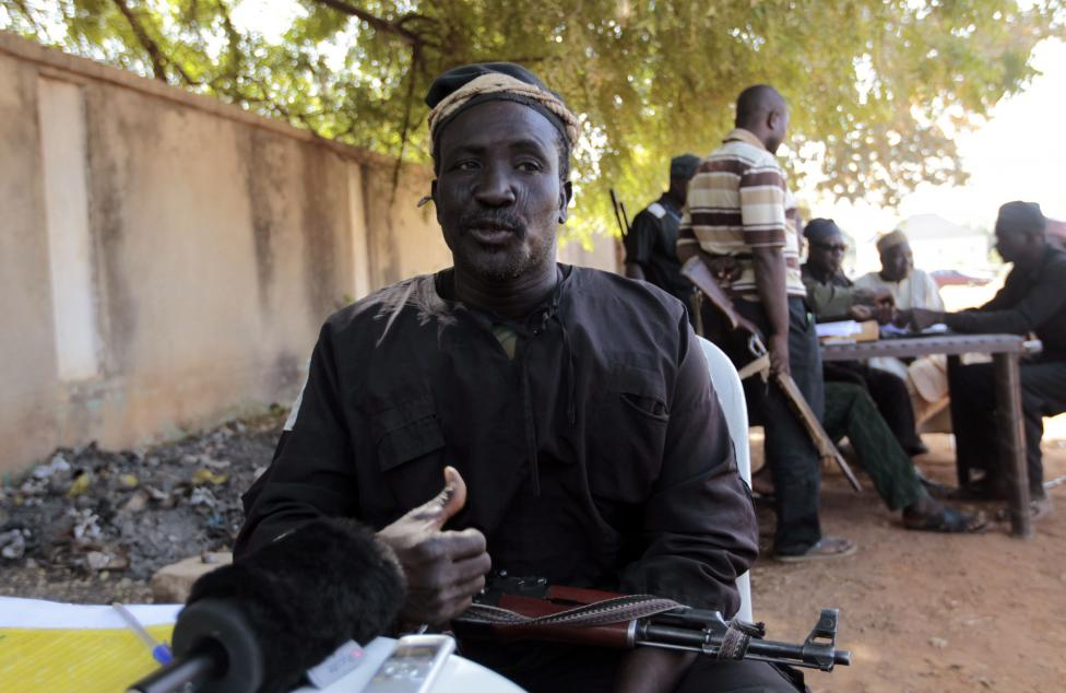Enoch, a leader of traditional militia hunters helping the army to fight the Boko Haram insurgence in the northeast region of Nigeria, speaks during an interview in Yola