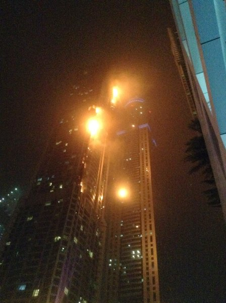 "A fire blazes at ""The Torch"", a residential high-rise tower, in Dubai"