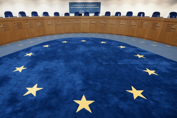 The European flag is pictured of the floor of a hearing room prior to the hearing regarding the complaint of a young French Muslim womans challenging France's full-face veil ban at the European Court of Human Rights (ECHR) in Strasbourg, eastern France on November 27, 2013.   AFP PHOTO/FREDERICK FLORIN        (Photo credit should read FREDERICK FLORIN/AFP/Getty Images)